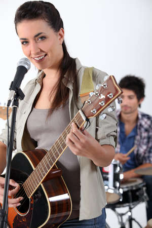 Woman with acoustic guitar photo