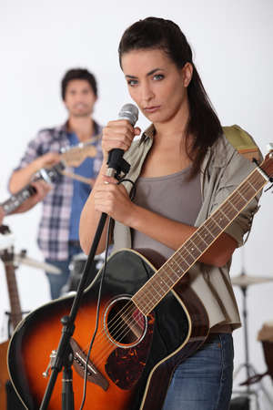 showbusiness: pretty brunette singing with band