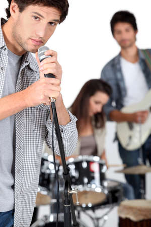 Young man singing in a band Stock Photo - 17479586