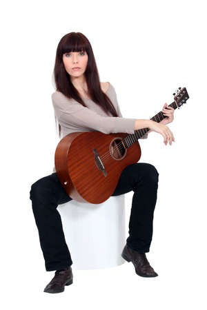 Woman playing the guitar Stock Photo - 17480285