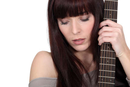 A woman with a guitar  photo