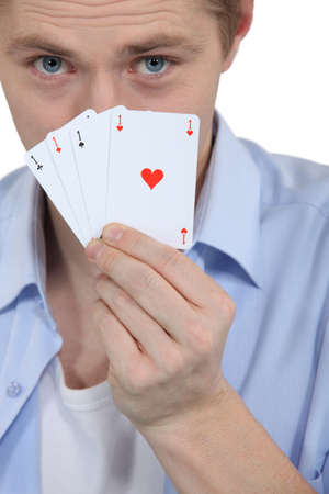 Man with four ACES Stock Photo - 17480510