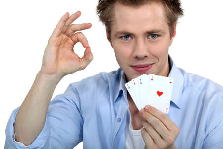 Young man holding playing cards photo