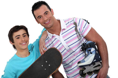 skate board: father and teenager enjoying sport together