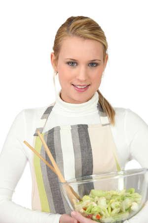 conviviality: pretty blonde preparing salad
