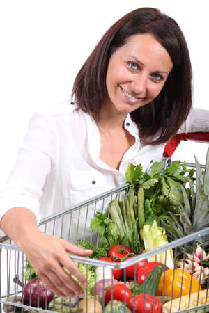 Woman with a trolley full of vegetables Stock Photo - 17479790