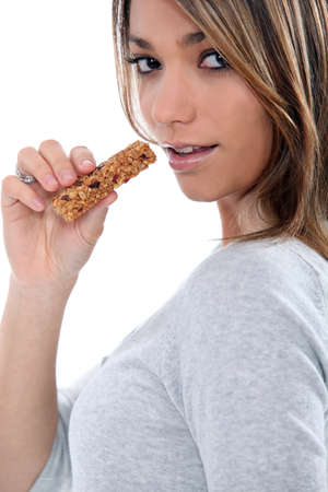 Woman holding cereal bar photo