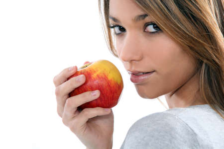 young woman holding an apple Stock Photo - 17480505