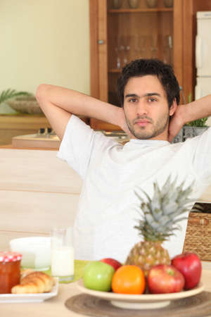 glasswear: Man relaxing in kitchen Stock Photo
