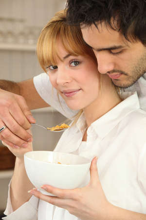 Couple eating bowl of cereal photo