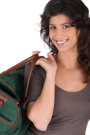 Woman carrying bag by handle photo