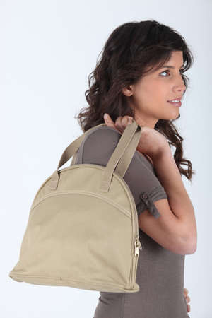 Profile of woman with bag photo