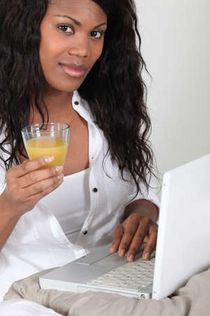 eyes hazel: Afro-American woman with glass of Stock Photo