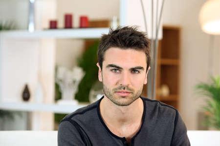 bachelor: Bachelor sat on sofa