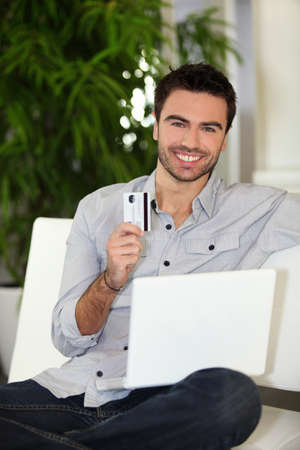 Man using a credit card online photo