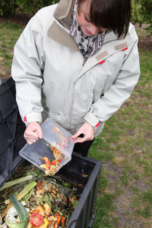 composting: Woman making a compost Stock Photo