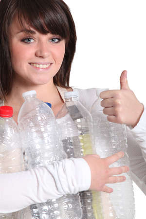 Woman recycling plastic bottles photo