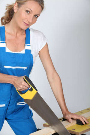 workmate: Woman sawing a piece of wood