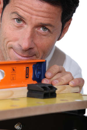 meticulous: Closeup of a man using a laser lever