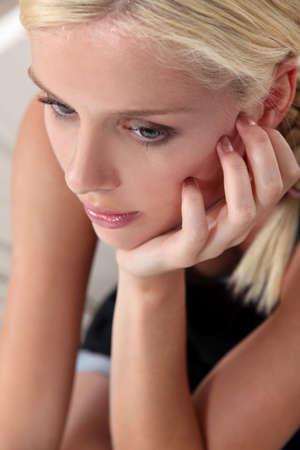 beautiful young woman thinking photo