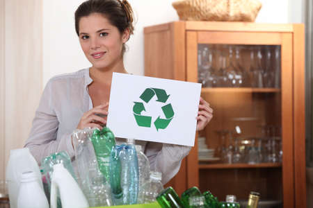 Woman holding the universal recycling sign Stock Photo - 17476248