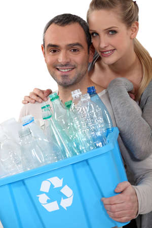 Couple taking out the recycling photo