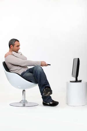 watching movie: Man watching television