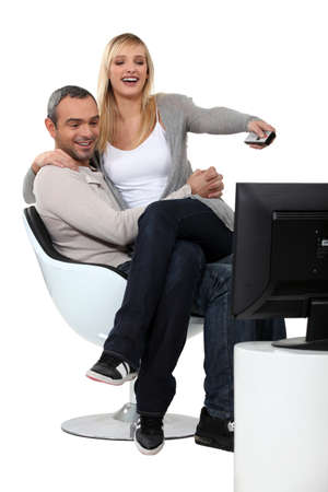 channel surfing: Couple channel surfing Stock Photo