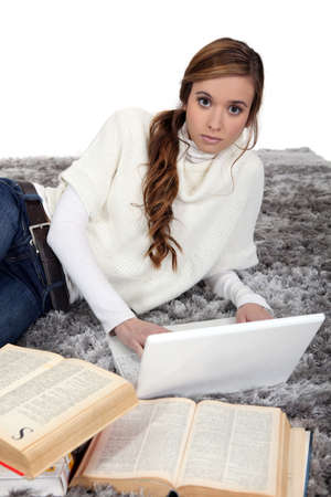 A cute girl studying Stock Photo - 17475793