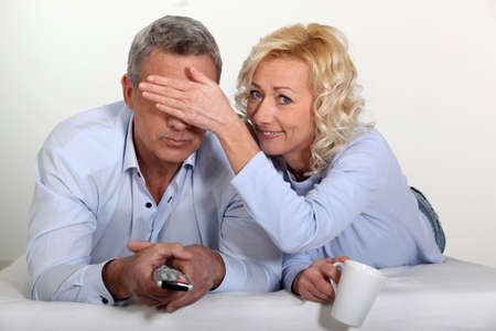 Couple watching television photo
