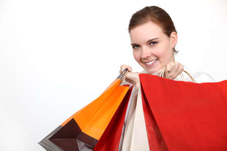 Woman holding numerous shopping bags photo