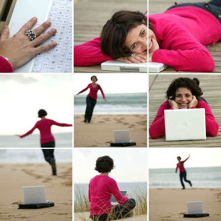 brunette wearing fuchsia pullover working at beach Stock Photo
