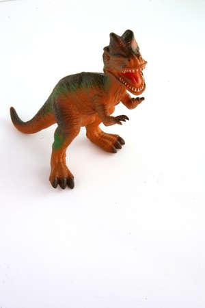 swallowing: Toy dinosaur Stock Photo