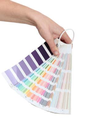 color fan: Hand holding a colour chart