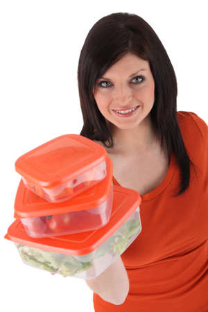 take away: Woman with Tupperware-like plastic food boxes
