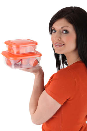 tupperware: woman holding boxes full of tomatoes