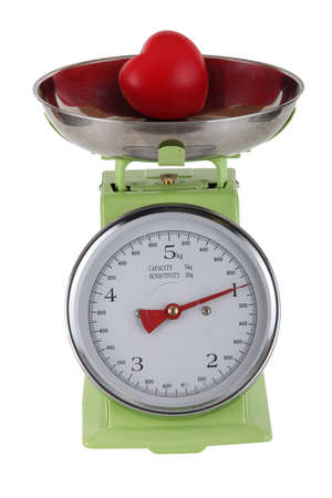 Tomato on a pair of scales photo