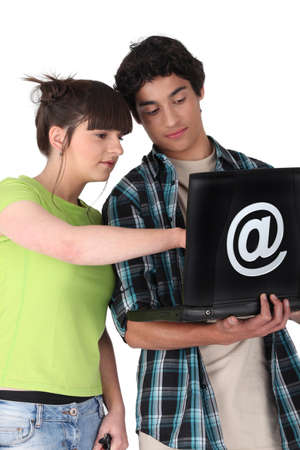 Teens with black computer Stock Photo - 17475784