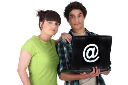 web presence internet presence: Young couple with a laptop