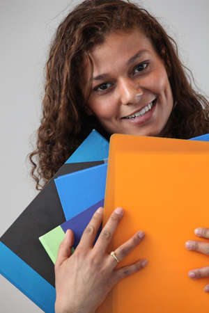 Administrative worker holding lots of folders photo