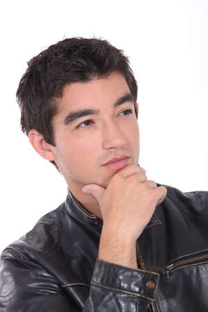 Young man posing in a leather biker jacket Stock Photo - 17475846