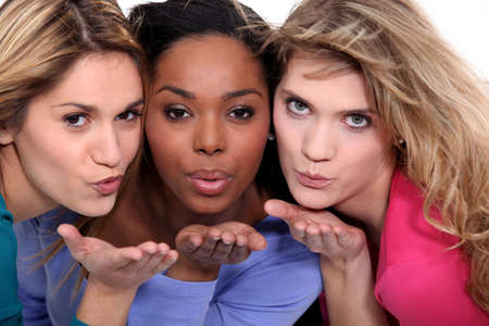 Female friends blowing kisses photo