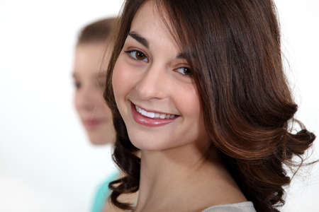all smiles: brunette student all smiles isolated on white Stock Photo