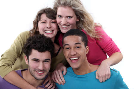 all smiles: happy young foursome Stock Photo