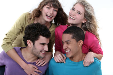 elated: elated young foursome of students Stock Photo