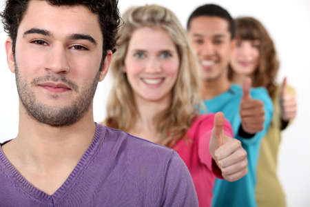 people in a row: Young group of people giving the thumb Stock Photo