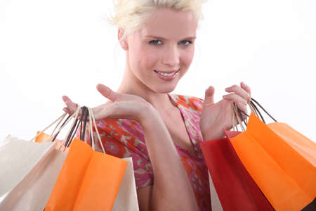 Young woman laden down with store bags Stock Photo - 17475898