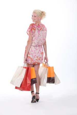 cash back: Attractive blond carrying shopping bags Stock Photo
