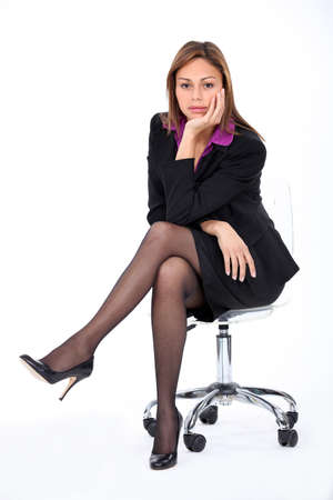 crossed legs: Corporate woman on a chair  Stock Photo