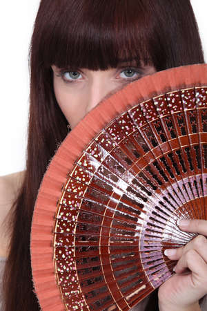 Woman holding oriental hand-fan photo